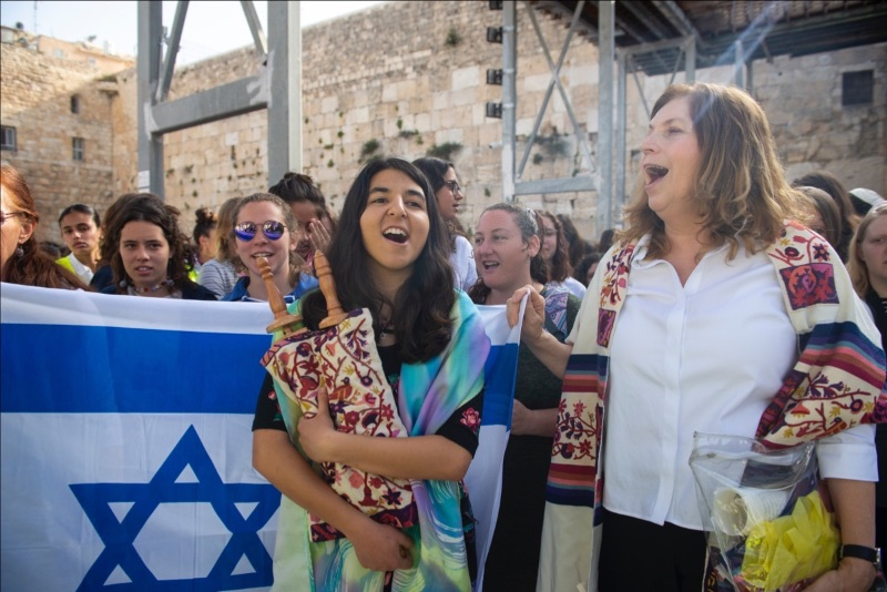 Leaving the Kotel with the Israeli flag and the Torah scrool