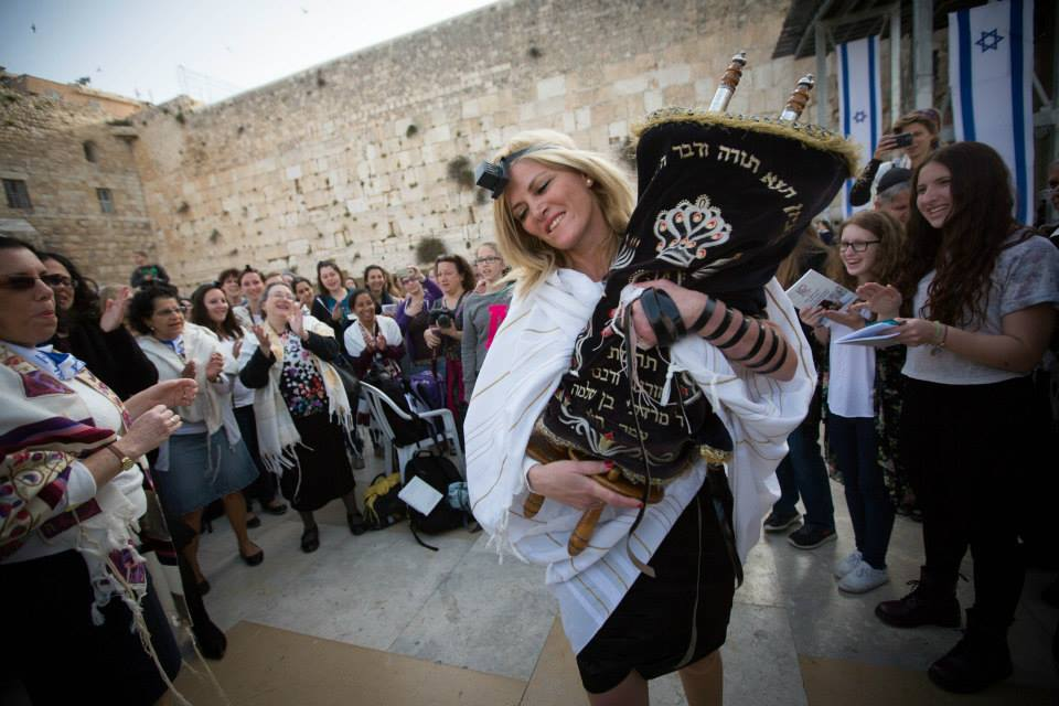 Women of the Wall participant with a torah scroll