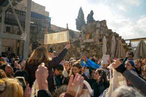 Anat lifting Torah Scroll